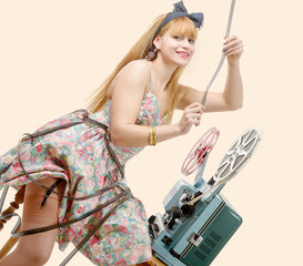 sexy pin-up girl with film reel and vintage projector