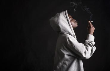 Portrait of black woman smoking