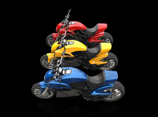 Sports motorcycles - red yellow and blue - isolated on black background