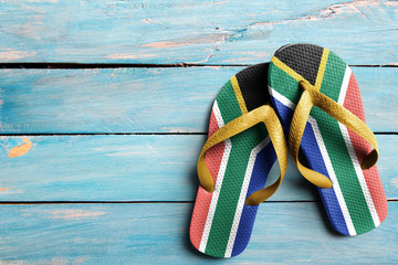 Thongs with flag of South Africa, on blue wooden boards