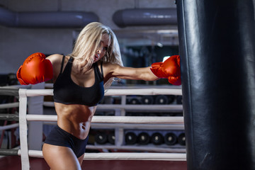 attractive young woman boxing at the gym