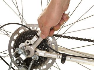 Man repairing rear wheel on a bicycle