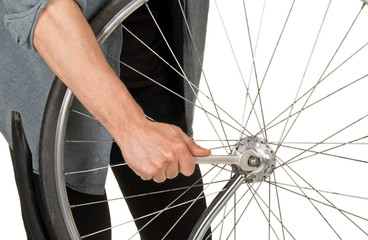 Man repairing front wheel on a bicycle