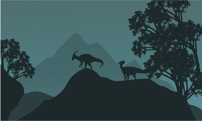 Silhouette of parasaurolophus in hills