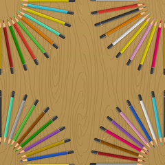 Colored pencils arranged like rays of sun. Color pencils on table.