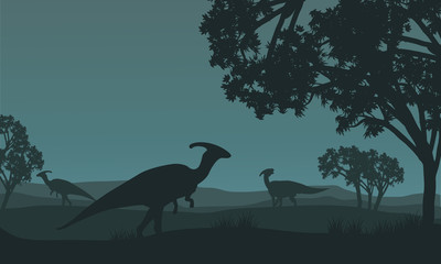 Silhouette of parasaurolophus walking in fields