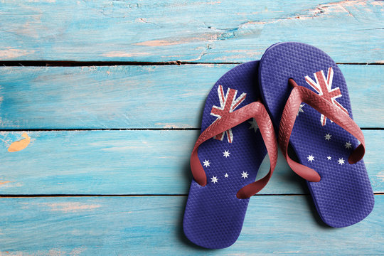 Thongs with flag of Australia, on blue wooden boards