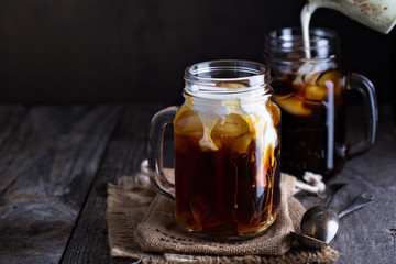 Iced coffee with milk in mason jars