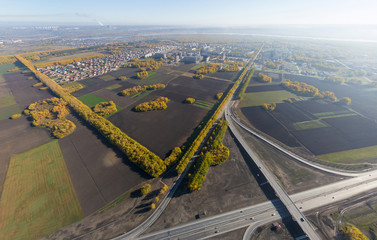 Aerial Road interchange, viaduct. Crossroads view, parks and parking lots, bridges. Copter shot. Panoramic image.