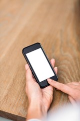 Cropped image of woman using smart phone