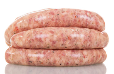Raw pork sausages isolated on white.