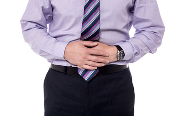 Cropped picture of man with stomach pain.