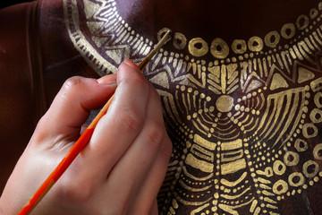 artist's hand on the body art