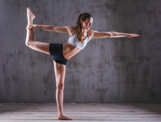 Sport yoga woman posing in photostudio. Fitness motivation picture