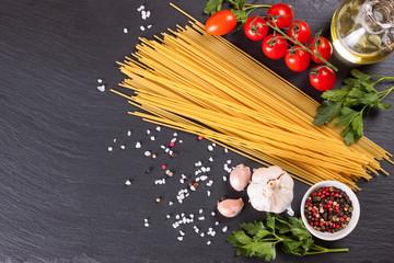 Pasta ingredients on black background.