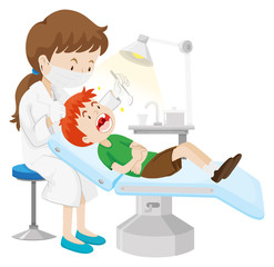Boy having teeth checked by dentist