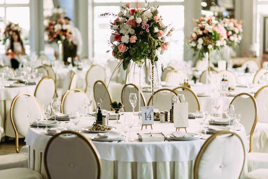 Luxury white restaurant is prepared for the wedding
