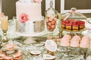 Wedding cake and pink macaroons
