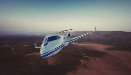 Photo of White Luxury Generic Design Private Jet Flying in Sky under the Earth Surface. Uninhabited Desert Mountains Background. Business Travel Picture. Wide. Film Effect. 3D rendering.