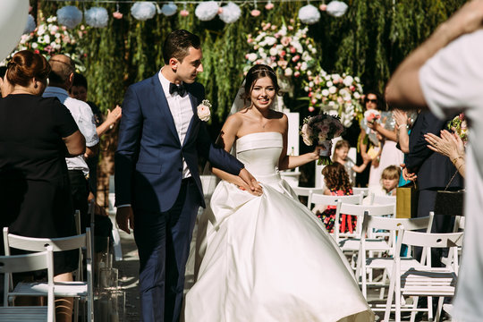 Happy wedding of a young  and beautiful couple