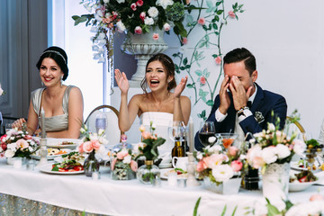 Happy married couple is applauding on the wedding