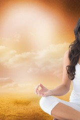 Composite image of a woman who is doing yoga