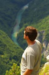 Man above Canyon of Tara River, Montenegro