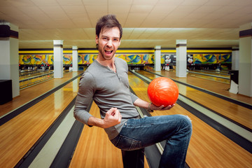 Young man at the bowling alley