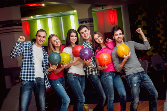 Cheerful friends at the bowling alley