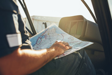 Helicopter pilot studying the flight route map