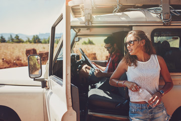 Young couple taking a break on road trip
