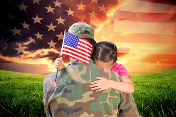 Composite image of A soldier who is holding his daughter