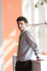 portrait of young business man at office
