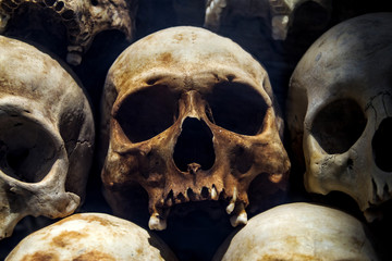 Human skulls at the Killing Fields of Choeung Ek, Phnom Penh, Cambodia.