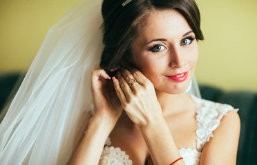 beautiful brunette stylish bride getting ready in the morning in the room