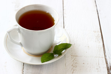 Cup of tea on wooden background