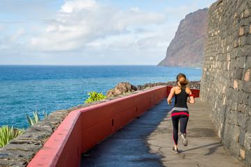 Sporty woman running seaside