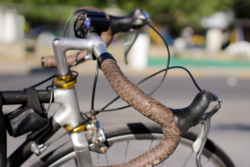 Bicycle handlebars and blurred background