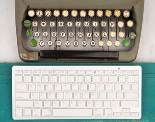 Concept of technology progress - old typewriter and new keyboard