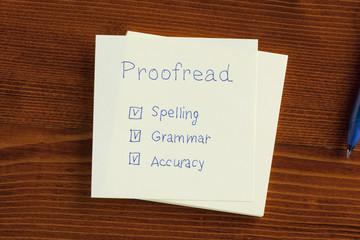 Proofread written on a note
