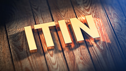 Acronym ITIN on wood planks
