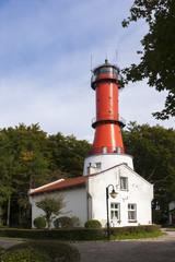 Lighthouse on a sunny day with blue sky.