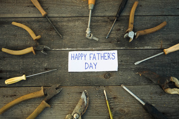 Desk of a carpenter with Happy fathers day sign.