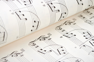 Close-up of white score sheet music notes.