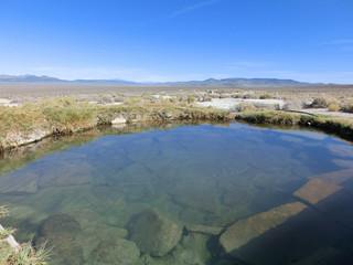 Natural hot spring pool in western USA desert