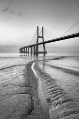 Vasco da Gama bridge at black and white, sunrise Lisbon