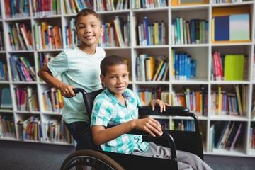 Boy pushing the wheelchair