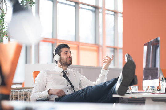 relaxed young business man at office