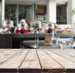 Rustic wooden table perspective showing interior of modern resta
