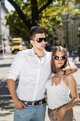 young couple in sunglasses in summer, city outdoor